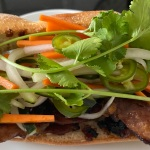 home made vietnamese banh mi sandwich with lemongrass pork